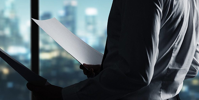 Man holding official document - Sentinel Risk